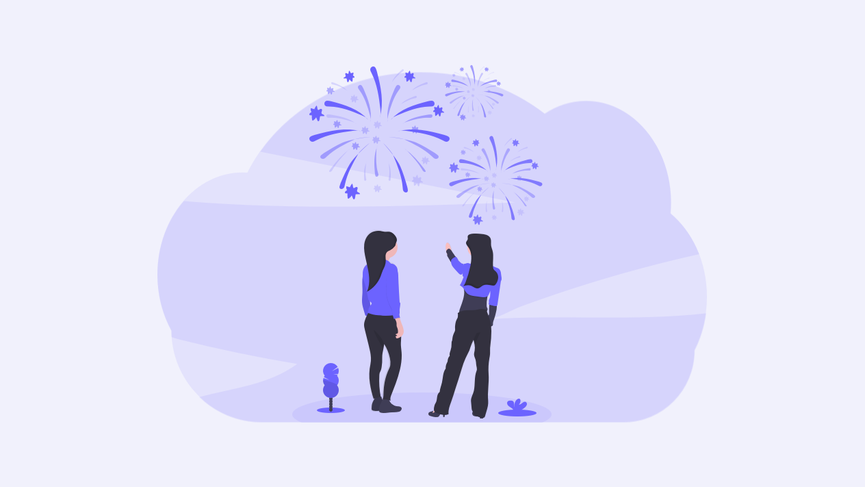 Two people watching fireworks explode above their heads
